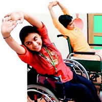 Two young wheelchair users stretching their arms