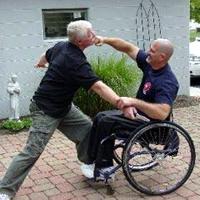 Wheelchair user defending himself