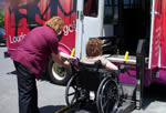Wheelchair user getting into a bus