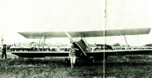 Nellie Willhite standing in front of an airplane